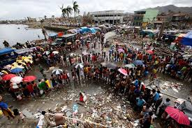 Victims of Typhoon Haiyan queue for food and water in Tacloban city, in the Philippines.